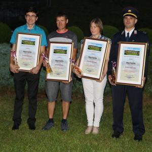 Letošnji nagrajenci KS Poljane (od leve proti desni): Janez Arnolj, Jože Košir, Hermina Peternel in Tadej Tavčar Foto: Franc Dolenec